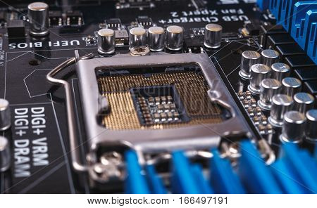 Printed Circuit Board with many electrical components. Close up image. Technology and hardware electronic concept