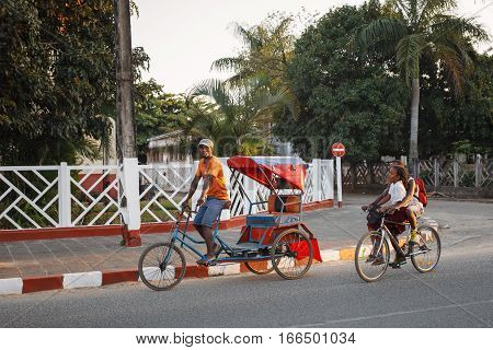 Traditional Rickshaw Bicycle With Malagasy Peoples In Toamasina, Madagascar