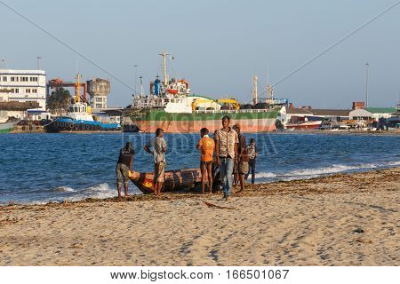 Malagasy Peoples Resting On The Beach In Harbor