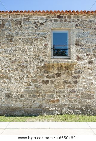 Repaired facade stone house, renovated historic facade with modern elements