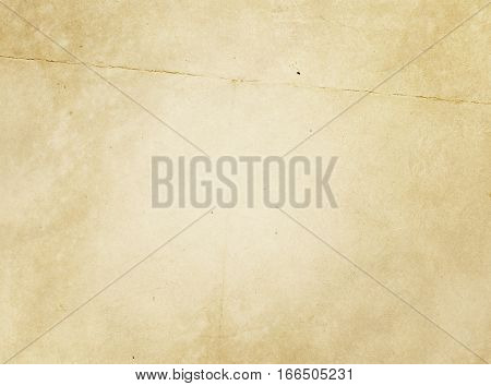 Aged dirty and crumpled paper background. Grunge paper texture for the design.