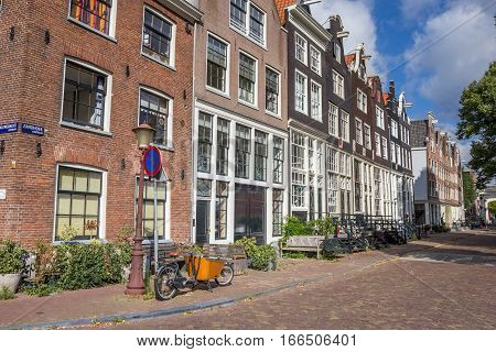 AMSTERDAM, NETHERLANDS - SEPTEMBER 18, 2016: Zandhoek street with traditional houses in Amsterdam, Netherlands