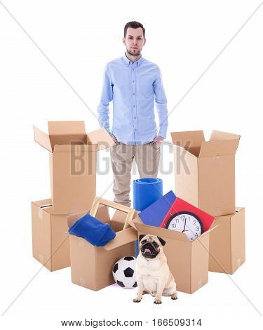 Moving Day Concept - Man With Brown Cardboard Boxes And Dog Isolated On White