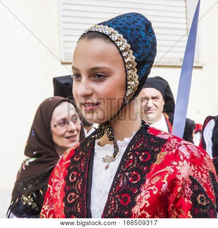 CAGLIARI, ITALY - May 1, 2013: 357 Religious Procession of Sant'Efisio - Sardinia - portrait of a beautiful girl in traditional Sardinian costume