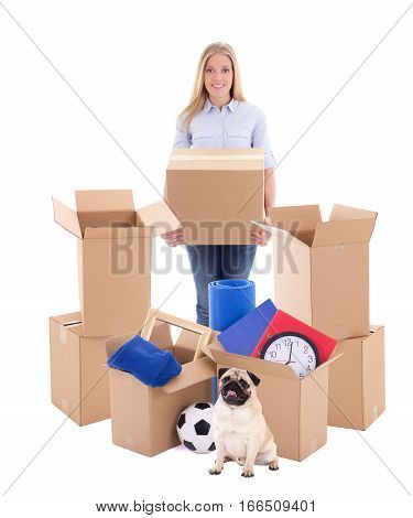 Moving Day Concept - Young Woman With Brown Cardboard Boxes And Dog Isolated On White