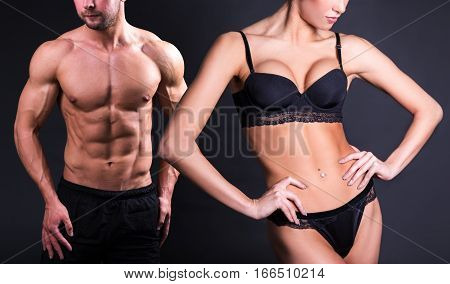 Close Up Of Sexy Female And Male Bodies Over Black