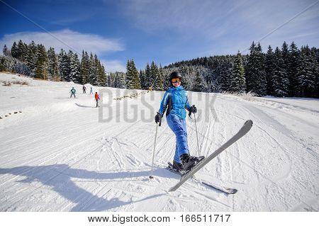 Female Skier On A Ski Slope At Ski Resort