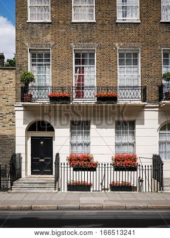 LONDON UK - 11 JUNE 2014: The facade to a traditional Georgian town house typical to the Bloomsbury district of central London.