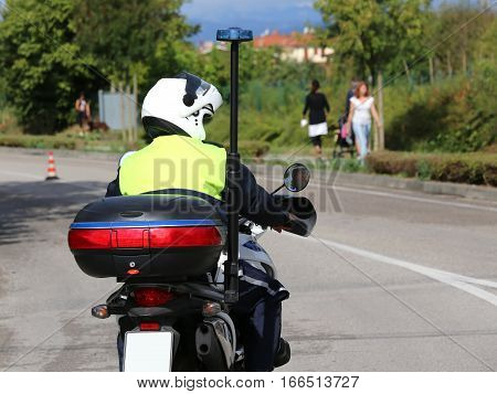 Policeman With Helmet On The Police Motorcycle