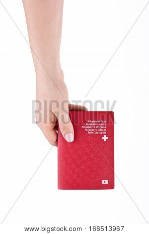 Woman's Hand Holding National Swiss Passport On A White Background