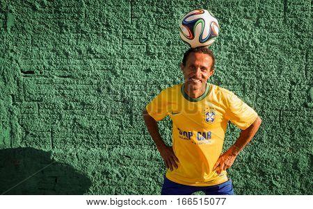 Brazilian Soccer Fan Balancing A Ball On His Head