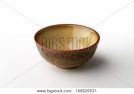 Ocher hand-crafted bowl isolated on white background