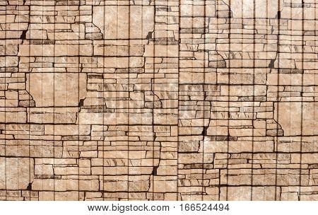 Brown background imitating the masonry of rough stone