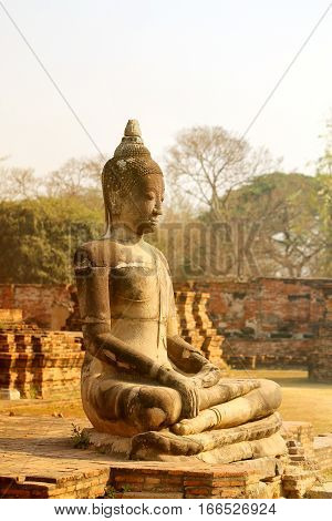 Photo of the ancient statue of Buddha in Thailand in the park