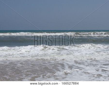 cool gray sea waves run on the coast