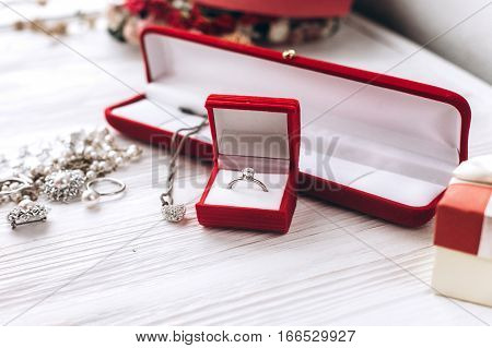 Stylish Luxury Jewelry Ring And Diamond Necklace On White Rustic Wooden Background. Greeting Card Wi