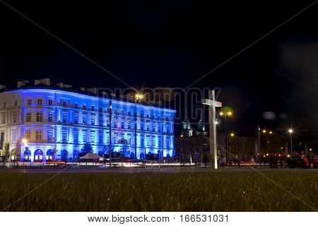 Poland warsaw 09.05.2015 - historic building entrance of the Pilsudski place cross in Warszaw night culture illumination