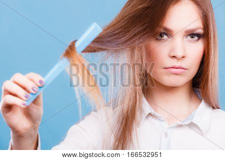 Care coiffure haidressing professional beauty concept. Girl with comb. Young smiling lady combing hairs changing haistyle.