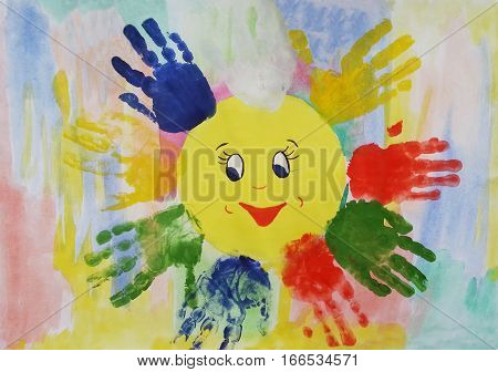 Colorful watercolor children handprints around the sun on the white background