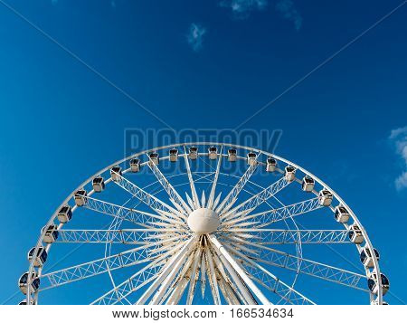 BRIGHTON, UK - 23 APRIL 2015: A low angle view of the prominent Brighton UK landmark and observation attraction The Brighton Wheel.