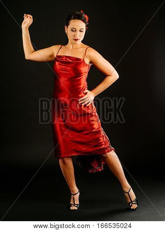 Photo of a beautiful woman performing tango dance moves.