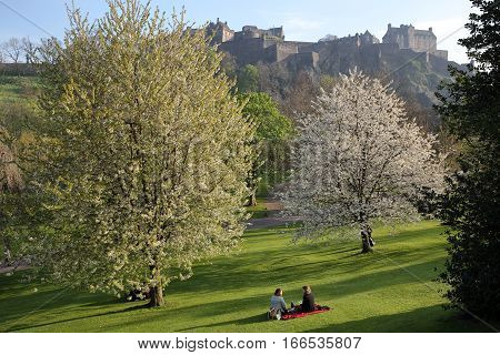 EDINBURGH, SCOTLAND - MAY 8, 2016: View of Edinburgh Castle and Princes Street Gardens with spring colors