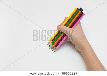 Women's Right Hand Draws A Dozen Pencils