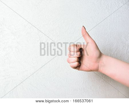 human female hand with positive gesture showing thumb up isolated on white background copy space
