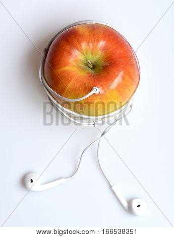 Apple Fruit With Mp3 Music Headphones Isolated On White