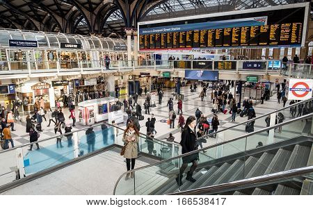 LONDON UK - 28 JANUARY 2016: Travellers and commuters waiting in the concourse of London's busy Liverpool Street train and tube station.