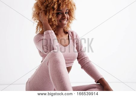 Happy Smiling Black Woman Touches Her Soft Curly Hair