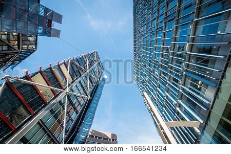 LONDON UK - 2 NOVEMBER 2016: Low and wide angle view of modern high rise apartment blocks in the Bankside area of London. The brick Tate Modern building is visible in the lower centre of the frame.