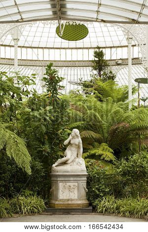 A reclining statue in the Kibble Palace, Glasgow Botanical Gardens, Scotland, UK