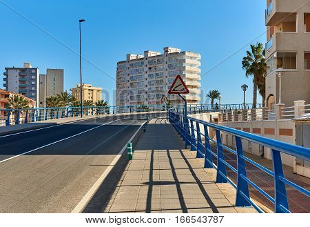 The 53 m long Bascule bridge of La Manga (La Manga del Mar Menor) in summer timetable it raises eight times a day. Region of Murcia Spain.