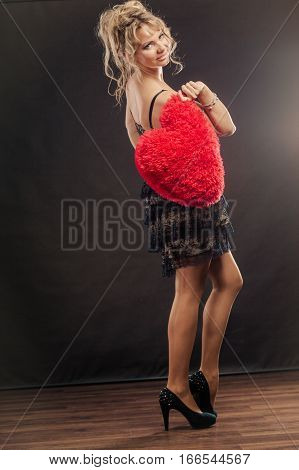 Mature Woman Holds Big Red Heart