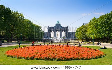 BRUSSELS BELGIUM - April 13, 2014: Triumphal Arch (Arc de Triomphe) in the Cinquantenaire park in Brussels with flowers. Front view.