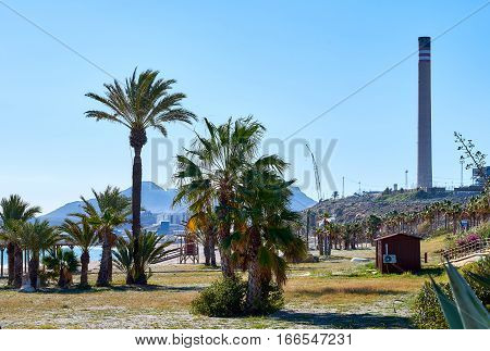 Beach and chimney of cement factory in Carboneras. Province of Almeria. Spain