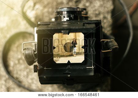 Stylish Happy Woman In Viewfinder Of  Analog Film Camera On Background Of City Old Wall