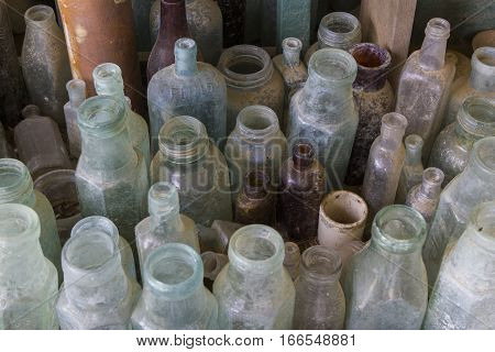 Overhead view of a selection of antique bottles in various colors