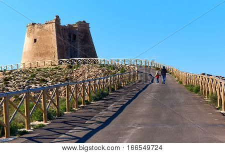 Footpath leading to the Mesa Roldan tower of 18th Century. It lies on a mountain east of the village of Agua Amarga in the province of Almeria. Cabo de Gata-Nijar Natural Park. Spain