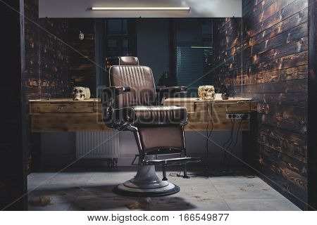 Stylish Vintage Barber Chair In Wooden Interior. Barbershop Theme