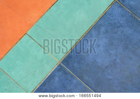Pavement pattern in orange blue and green background