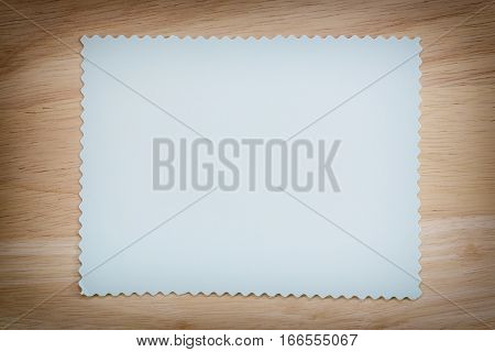 Blue paper blank on the brown wooden floor of vintage color and You can input the message in copy space.