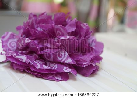 Purple & white tissue paper bow on white