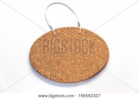 Oval frameless corkboard hanging sign ready for text
