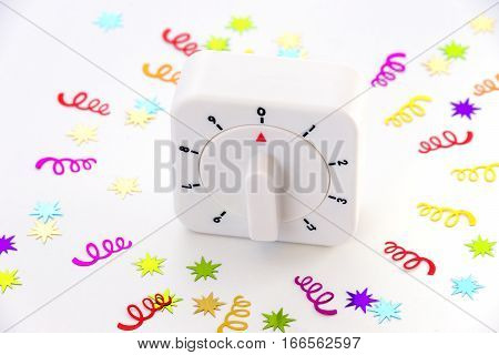 A countdown timer at zero with stars and spiral confetti bursting out around it