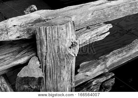 Rustic wood log fence high contrast in black and white