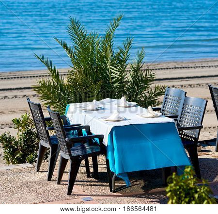 Outdoors restaurant near the beach in La Manga (La Manga del Mar Menor) is a seaside spit in the Region of Murcia Spain.