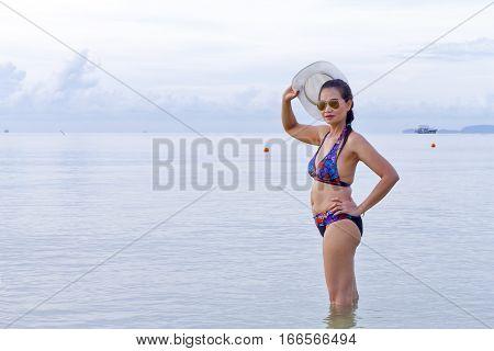Women body beautiyful relax on Thung Wua Lan Beach at Chumphon Province Thailand