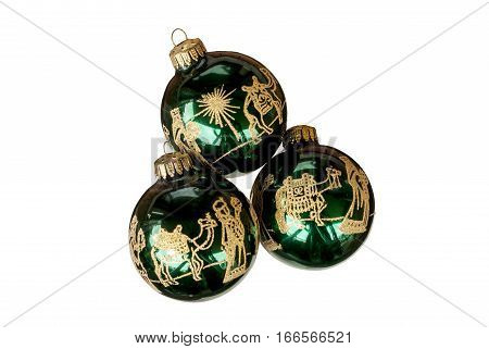 Three green and gold ornaments depicting the three wise men on white background.